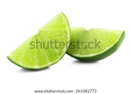 Juicy slices of lime isolated on white - stock photo