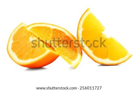 Juicy slices of orange isolated on white - stock photo
