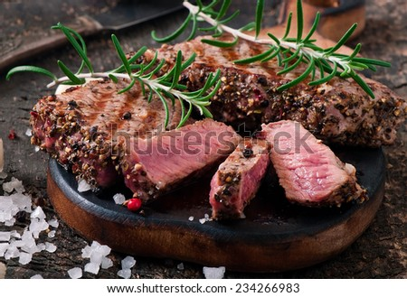 Juicy steak medium rare beef with spices - stock photo