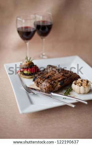 juicy steak with wine - stock photo