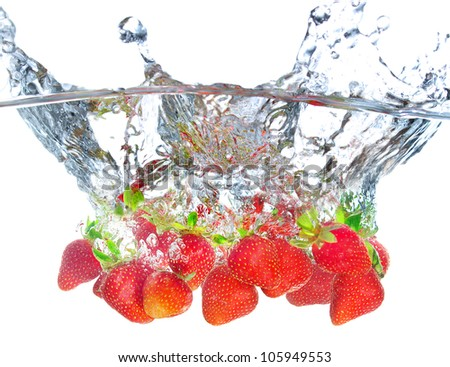 Juicy strawberry and water splash. Tasty and healthy food - stock photo