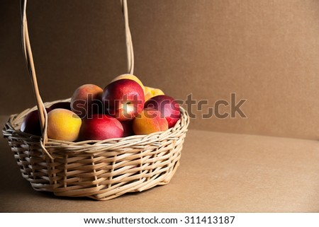 Juicy summer peaches in the pot on the table. Fresh fruits on the table. The best choice of Nature�¢??s mix. Still life of summer. - stock photo