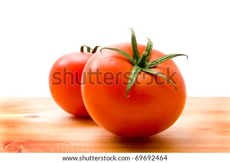 juicy tomatoes on a white background - stock photo