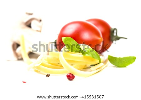 juicy tomatoes with spaghetti and basil - stock photo
