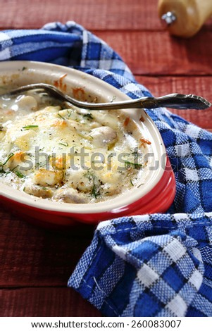 Julienne with cheese in baking dish, food - stock photo
