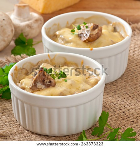 Julienne with mushrooms and cream on white bowl - stock photo