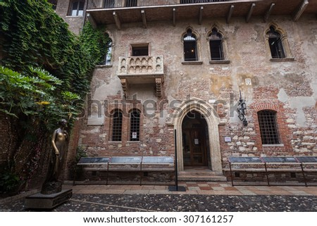 Juliet's balcony and Juliet statue - Verona - Italy - stock photo
