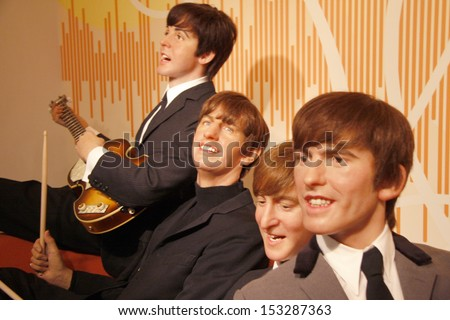 "JULY 10, 2008 - BERLIN: the wax figures of the ""Beatles"" with Paul McCartney, Ringo Starr, John Lennon and George Harrison - official opening of the waxworks ""Madame Tussauds Berlin"", Berlin.  - stock photo"