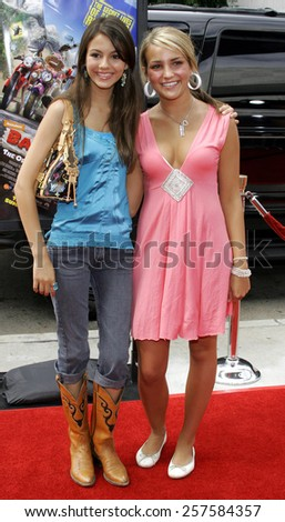 """July 30, 2006. Jamie Lynn Spears and Victoria Justice attend the World Premiere of """"Barnyard"""" held at the Cinerama Dome in Hollywood, California United States.  - stock photo"""