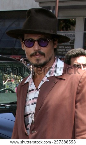 """July 10, 2005. Johnny Depp attends at the """"Charlie and the Chocolate Factory"""" World Premiere at the Grauman's Chinese Theatre in Hollywood.  - stock photo"""