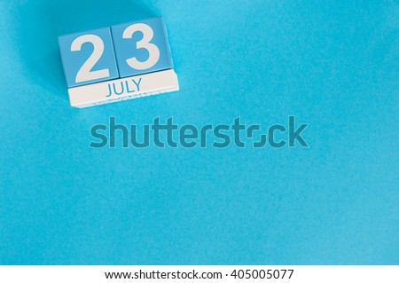 July 23rd. Image of july 23 wooden color calendar on blue background. Summer day. Empty space for text. National Hot Dog Day. World Whale and Dolphin DAY - stock photo