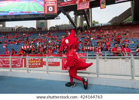 July 24, 2015 - Shah Alam, Malaysia: Liverpool FC's mascot 'Mighty Red' greets fans and supporters before the friendly game against Malaysia. Liverpool Football Club from England is on an Asia tour. - stock photo