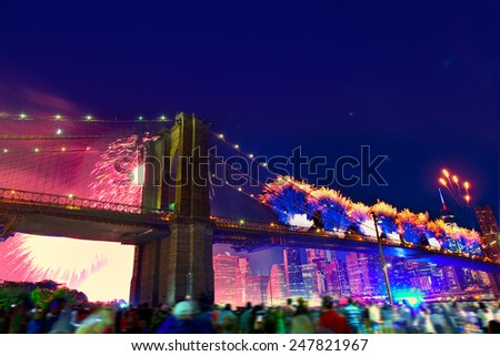 July 4th 2014 fireworks at Brooklyn bridge Manhattan skyline New York USA - stock photo