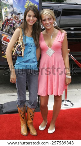 """July 30, 2006. Victoria Justice and Jamie Lynn Spears at the World Premiere of """"Barnyard"""" held at the Cinerama Dome in Hollywood, California United States.  - stock photo"""