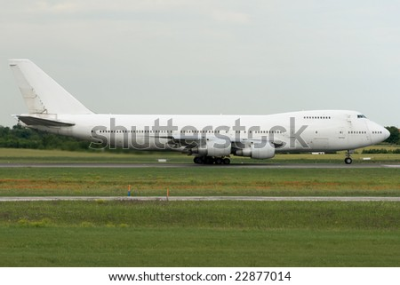 Jumbo jet airplane accelerating - stock photo