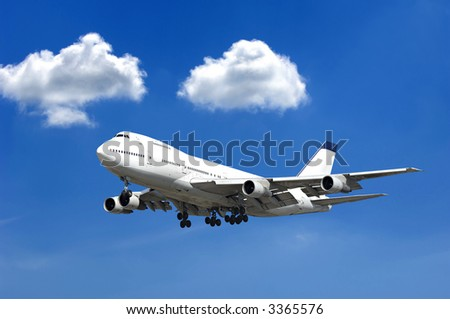 Jumbo jet and two clouds on a blue sky - stock photo