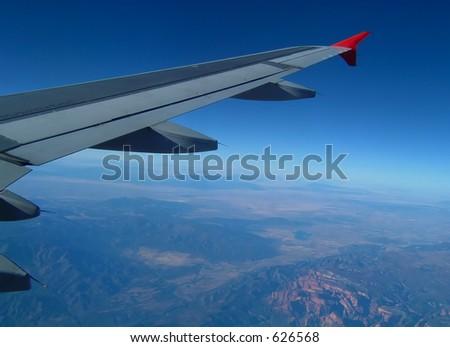 Jumbo Jet Over American Southwest - stock photo