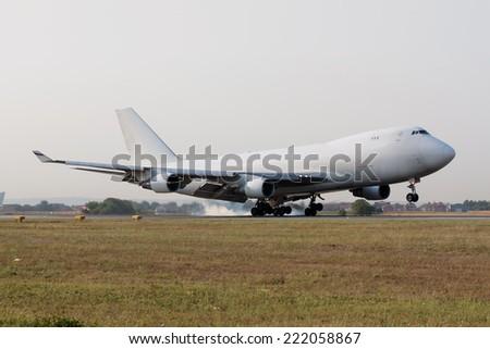 Jumbo Jet touchdown - stock photo