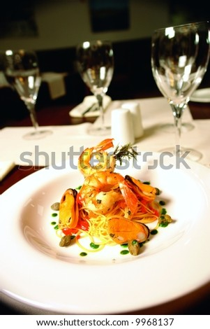Jumbo shrimp with mussels and served over spaghetti - stock photo