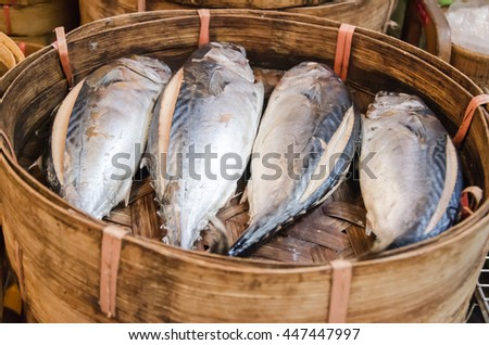 Jumbo Skipjack tuna 4 pieces  are in fish baskets which made from bamboo. - stock photo