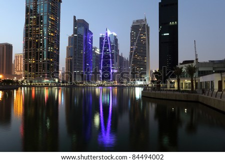 Jumeirah Lake Towers at night. Dubai, United Arab Emirates - stock photo