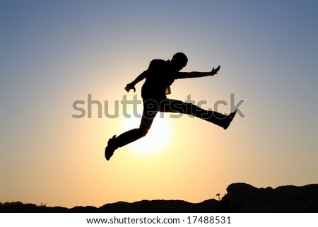 jump for joy silhouette - stock photo