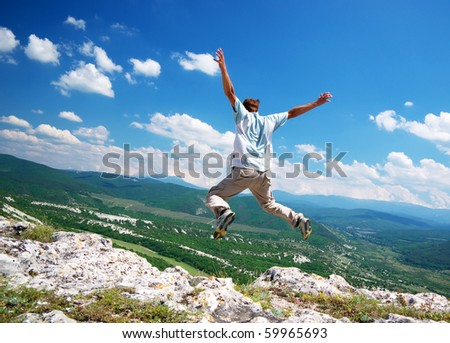 Jump from the cliff.Dynamic and emotional scene. - stock photo