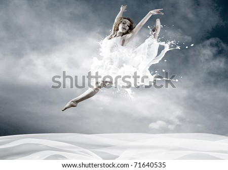 Jump of ballerina with dress of milk - stock photo