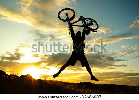 jump with a mountain bike - stock photo