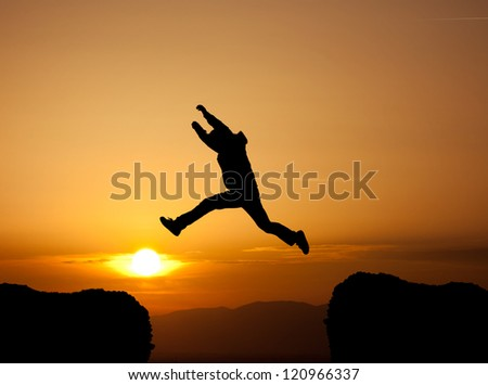 jumping a gap in sunset - stock photo