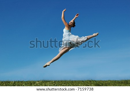 Jumping ballerina on a sunny day - stock photo