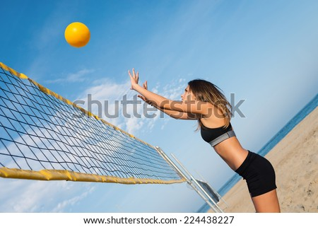 Jumping beach volleyball female player portrait. - stock photo