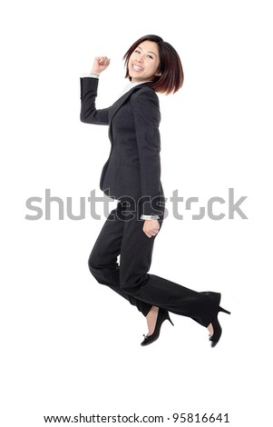 Jumping business woman. Celebrating successful businesswoman in suit jumping joyful isolated on white background in full length. Beautiful Asian female model. - stock photo