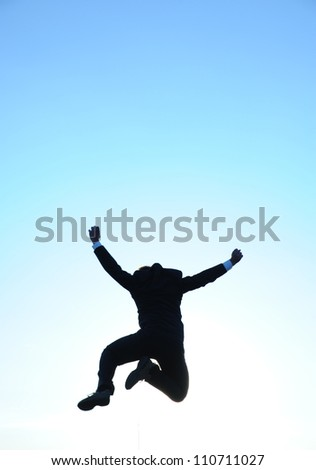 Jumping businessman and blue sky - stock photo