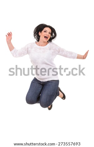 Jumping casual cheerful woman isolated on white background - stock photo
