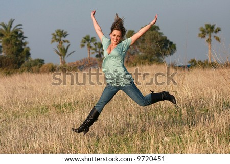 jumping girl  autumn jeans - stock photo