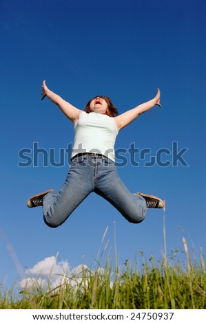 jumping girl on a background of the cloudy sky - stock photo