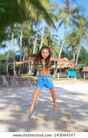 Jumping girl on the beach - stock photo