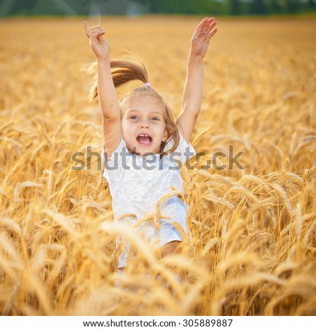 Jumping kids in the wheat field - stock photo