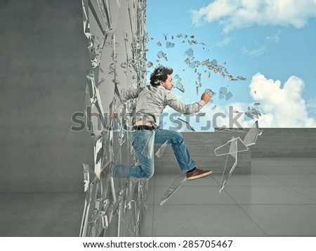 jumping man breaking glass to go outside - stock photo