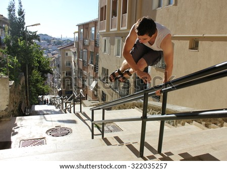 Jumping man in active street life-style, parkour. Istanbul, Turkey. - stock photo