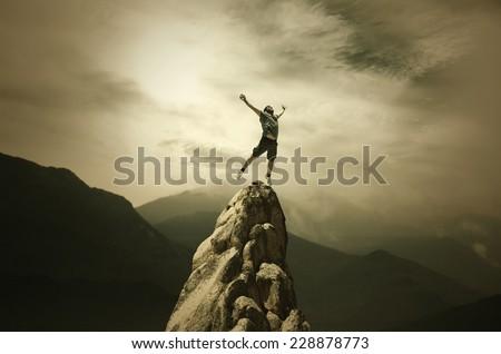 Jumping Man on the Peak - stock photo
