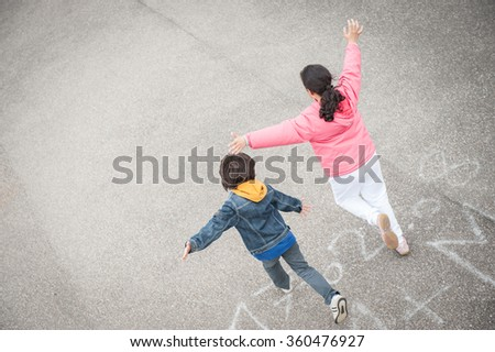 Jumping running kid on the street - stock photo