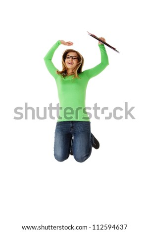 Jumping student girl, isolated on white background - stock photo