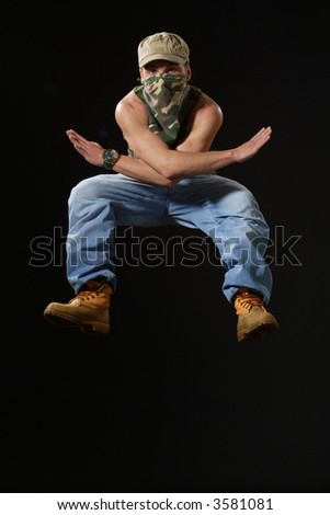 jumping up krump style dancer - stock photo