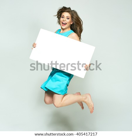 Jumping woman holding white sign board. isolated portrait. - stock photo