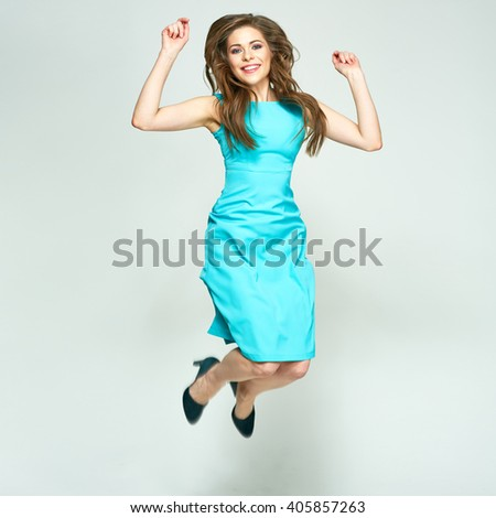 Jumping woman isolated portrait. Happy emotional girl. Long hair in motion. - stock photo