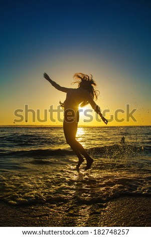 jumping woman silhouette - stock photo
