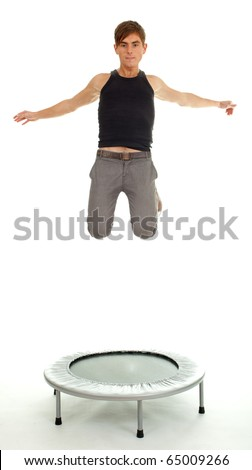 jumping young handsome man on the trampoline, white background - stock photo