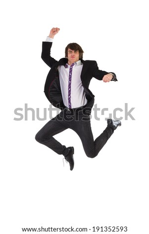 Jumping young man. Elegance young man jumping in the air. Full length studio shot isolated on white. - stock photo